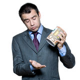 Portrait of businessman holding money box Stock Images