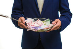 Portrait of a businessman holding money in hand Stock Image