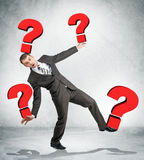 Portrait of businessman holding red question marks Royalty Free Stock Images
