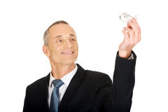 Portrait of businessman holding small airplane Stock Photos