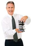 Portrait of businessman holding stack of phones Stock Images