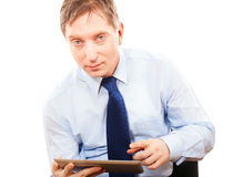 Portrait businessman holding tablet pc Royalty Free Stock Images