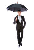 Portrait of a businessman holding umbrella Royalty Free Stock Images