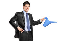Portrait of a businessman holding a watering can Royalty Free Stock Photography
