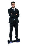Portrait of businessman on hoverboard stock photos