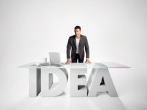 Portrait of a businessman leaning on IDEA table Royalty Free Stock Photo