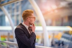 Portrait of businessman looking the future on blurred city backg. Round. Business success concept Royalty Free Stock Photos