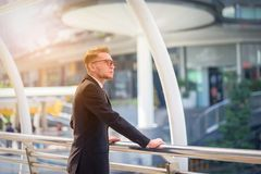 Portrait of businessman looking the future on blurred city backg. Round. Business success concept Royalty Free Stock Image