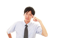 Portrait of businessman looking uneasy. royalty free stock images