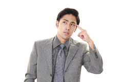 Portrait of businessman looking uneasy. Royalty Free Stock Photography