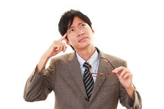Portrait of businessman looking uneasy. Stock Photo
