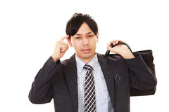 Portrait of businessman looking uneasy. Stock Images