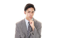 Portrait of businessman looking uneasy. Royalty Free Stock Photo