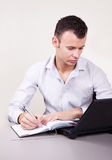 Portrait of businessman making notes Royalty Free Stock Photography