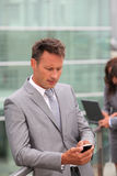 Portrait of businessman with mobile phone Stock Photos