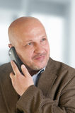 Portrait of a businessman with a mobile phone. Stock Photo