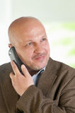 Portrait of a businessman with a mobile phone. Stock Photos