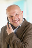 Portrait of a businessman with a mobile phone.  Royalty Free Stock Image