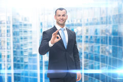 Portrait of businessman ok gesturing Royalty Free Stock Images