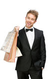 Portrait of businessman with paper bags Royalty Free Stock Photo