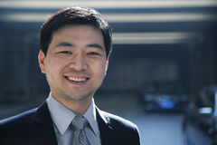 Portrait of businessman in a parking garage Stock Photo