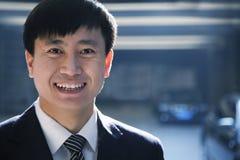 Portrait of businessman in a parking garage Stock Images
