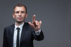 Portrait of businessman pointing finger gestures Royalty Free Stock Photos
