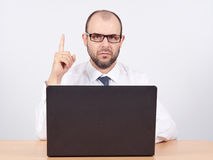 Portrait of businessman pointing finger up Stock Image