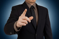 Portrait of businessman pointing finger at viewer Royalty Free Stock Images