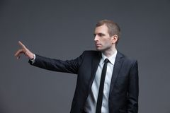 Portrait of businessman pointing hand gestures Royalty Free Stock Photography