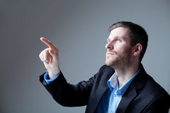 Portrait of businessman pointing Stock Photo