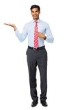 Portrait Of Businessman Pointing At Invisible Product Royalty Free Stock Photo