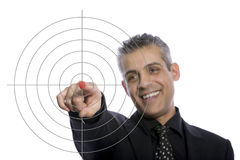 Portrait of a businessman pointing at a target Royalty Free Stock Image