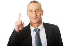 Portrait of businessman pointing upwards Stock Photography