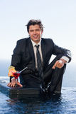 Portrait of a businessman posing with a cocktail in a briefcase Royalty Free Stock Photos