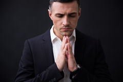 Portrait of a businessman praying Royalty Free Stock Photo