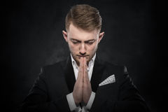 Portrait of businessman praying or thinking. Royalty Free Stock Photo