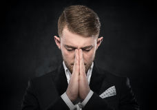 Portrait of businessman praying or thinking. Stock Image