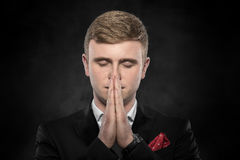 Portrait of businessman praying or thinking. Stock Images