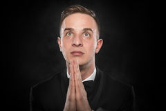 Portrait of businessman praying or thinking. Stock Photography