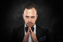 Portrait of businessman praying or thinking. Royalty Free Stock Images
