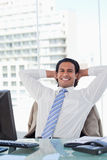 Portrait of a businessman relaxing in his office Royalty Free Stock Photo