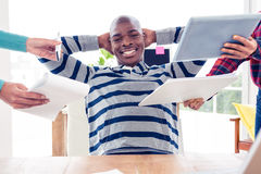 Portrait of businessman relaxing in office Royalty Free Stock Images