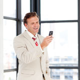 Portrait of a businessman sending a text Royalty Free Stock Photos