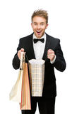 Portrait of businessman with shopping bags Stock Images