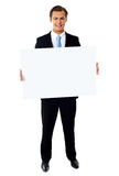 Portrait of businessman showing blank signboard Royalty Free Stock Photography