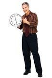 Portrait of businessman showing clock Stock Image