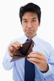 Portrait of a businessman showing his empty wallet. Against a white background Royalty Free Stock Photography