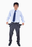 Portrait of a businessman showing his pockets Royalty Free Stock Photo