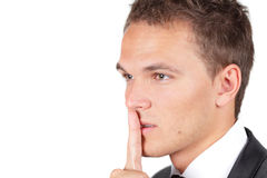 Portrait of businessman showing silence gesture Royalty Free Stock Image